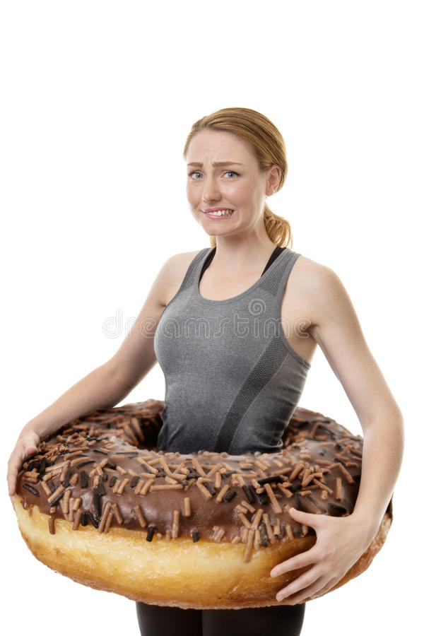 Large donut around woman royalty free stock images