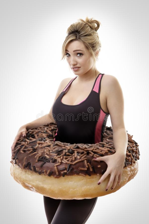 Large donut around woman stock image