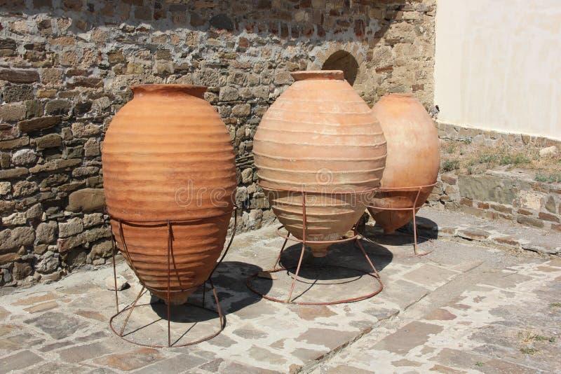 Large earthen vessels inside the fortress in Sudak Crimea stock images