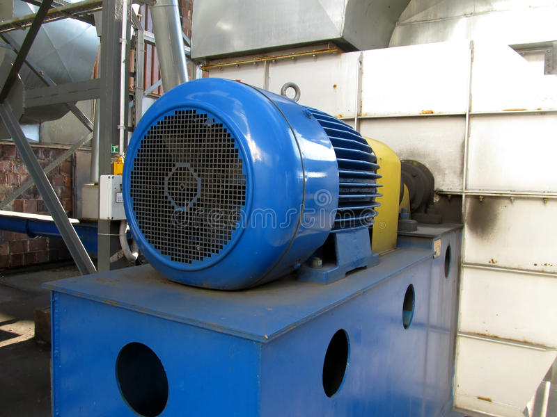 Large electric motor of blue color as the drive to the fan. Large electric motor of blue color as the drive to the exhaust fan royalty free stock photos