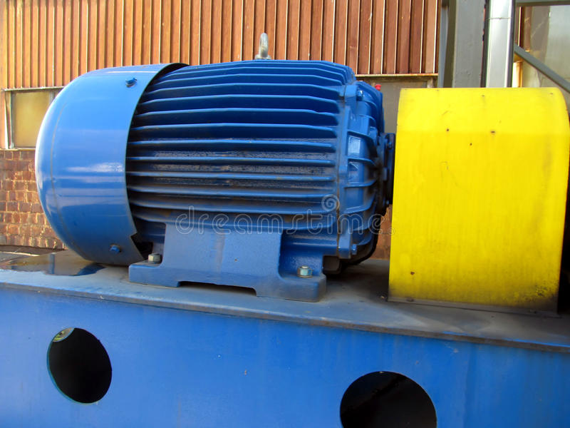 Large electric motor of blue color as the drive to the fan. Large electric motor of blue color as the drive to the exhaust fan royalty free stock photography