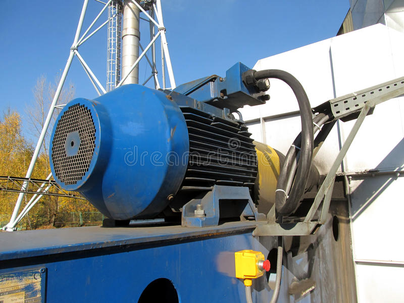 Large electric motor of blue color as the drive to the fan. Large electric motor of blue color as the drive to the exhaust fan stock image