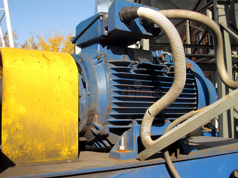 Large electric motor of blue color as the drive to the fan. Large electric motor of blue color as the drive to the exhaust fan royalty free stock image