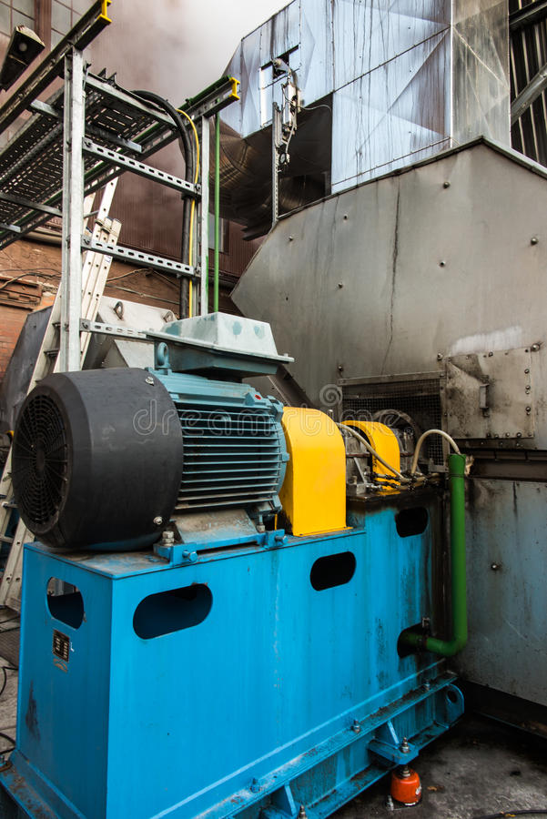 Large electric motor. Used to drive the fan exhaust stock image