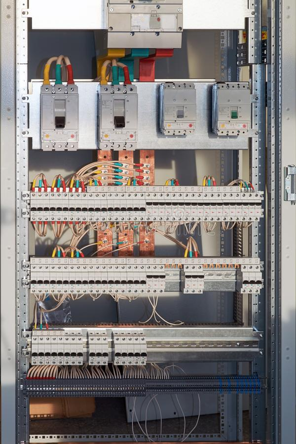 Large electrical switch Cabinet with circuit breakers and terminals royalty free stock images
