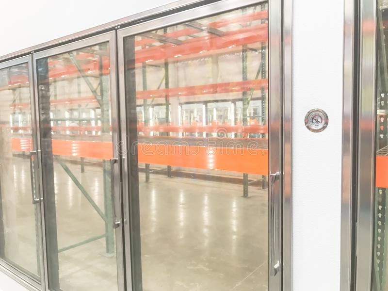 Large empty commercial fridges with temperature control at wholesale big-box store. Temperature control and empty, recently remodeled large commercial fridges at royalty free stock images