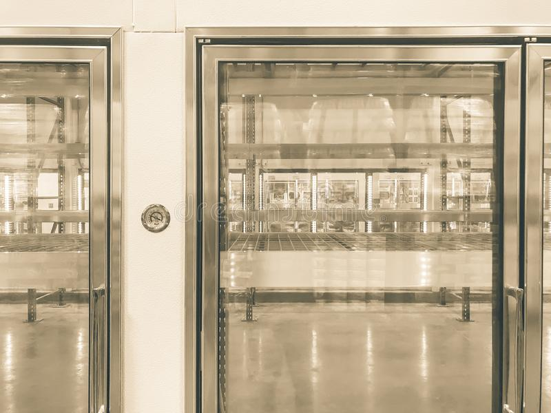 Large empty commercial fridges with temperature control at wholesale big-box store. Temperature control and empty, recently remodeled large commercial fridges at royalty free stock photos