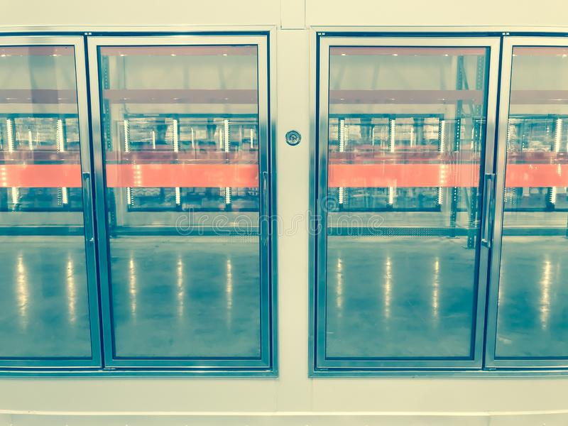 Large empty commercial fridges with temperature control at wholesale big-box store. Temperature control and empty, recently remodeled large commercial fridges at royalty free stock photography