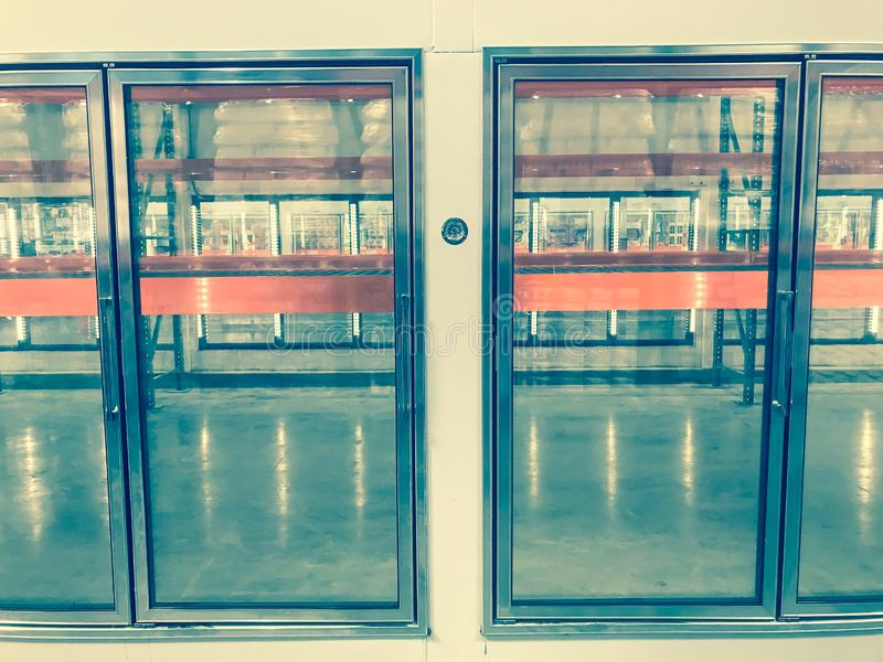Large empty commercial fridges with temperature control at wholesale big-box store. Temperature control and empty, recently remodeled large commercial fridges at stock photo