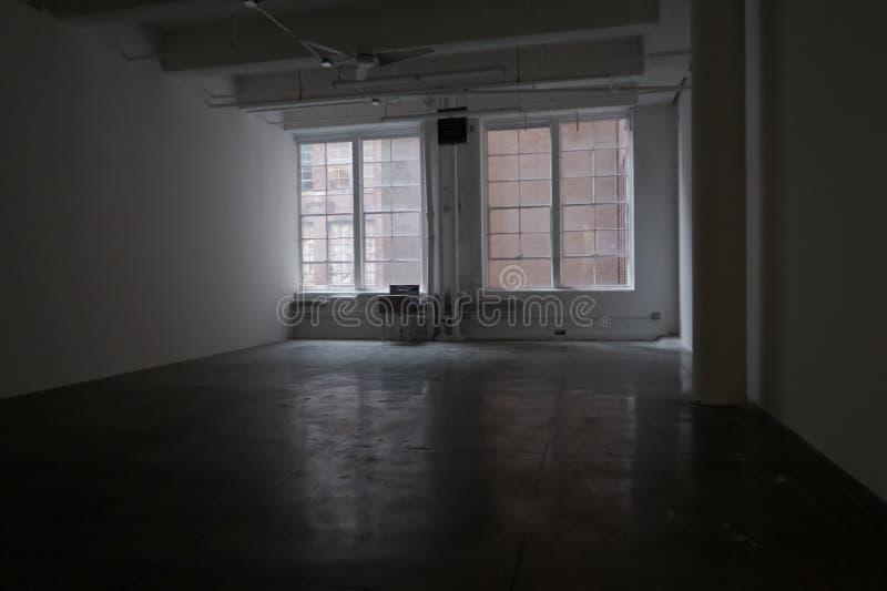 Large empty concrete studio stock image