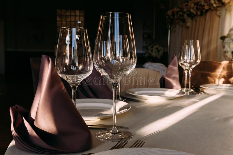 Large empty glass wine glasses on table in restaurant royalty free stock photos