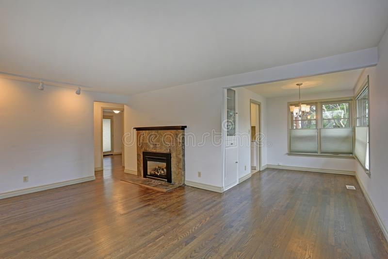 Large empty living area with hardwood floor stock photo