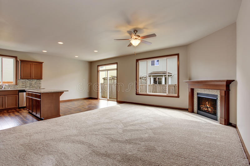 Large empty living room interior with carpet floor and fireplace. stock photography