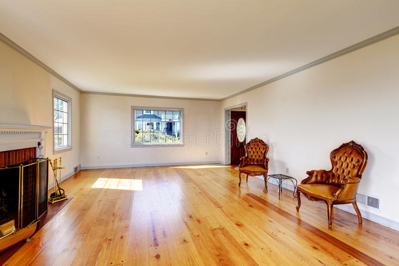 Large empty old living room interior with fireplace. royalty free stock photos