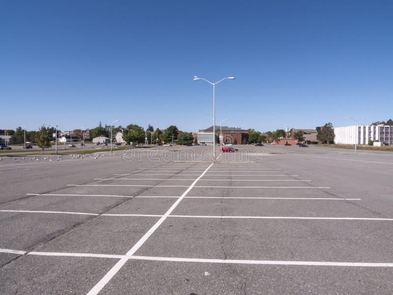 [Image: large-empty-parking-lot-orono-maine-usa-...619068.jpg]