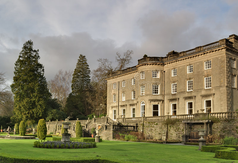 Large English Country house and garden. A Large Country house at Rydal in the English lake District, with a formal garden designed by Thomas Mawson royalty free stock photo