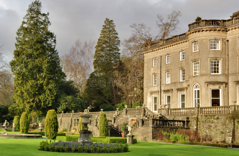 Large English Country house and garden. A Large Country house at Rydal in the English lake District, with a formal garden designed by Thomas Mawson stock image