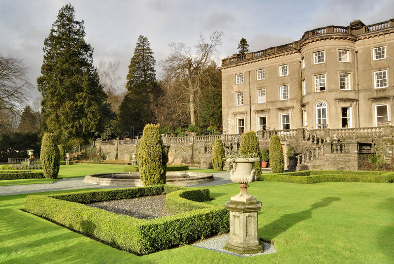Large English Country house and garden. A Large Country house at Rydal in the English lake District, with a formal garden designed by Thomas Mawson royalty free stock photography