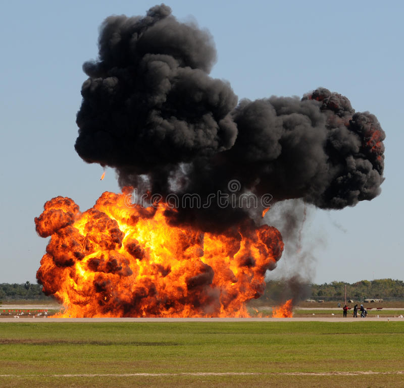 Large explosion. Giant outdoors explosion with fire and black smoke royalty free stock image