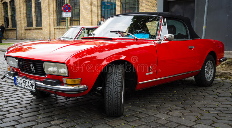 Large family car Peugeot 504 convertible. BERLIN - MAY 10, 2015: Large family car Peugeot 504 convertible. 28th Berlin-Brandenburg Oldtimer Day stock photos