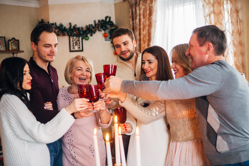 Large family celebrates Christmas and drinking champagne royalty free stock photos
