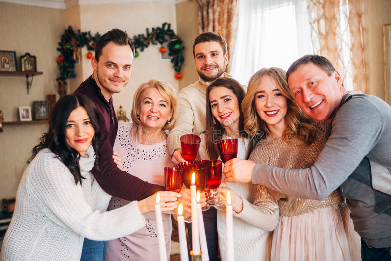 Large family celebrates Christmas and drinking champagne stock photos