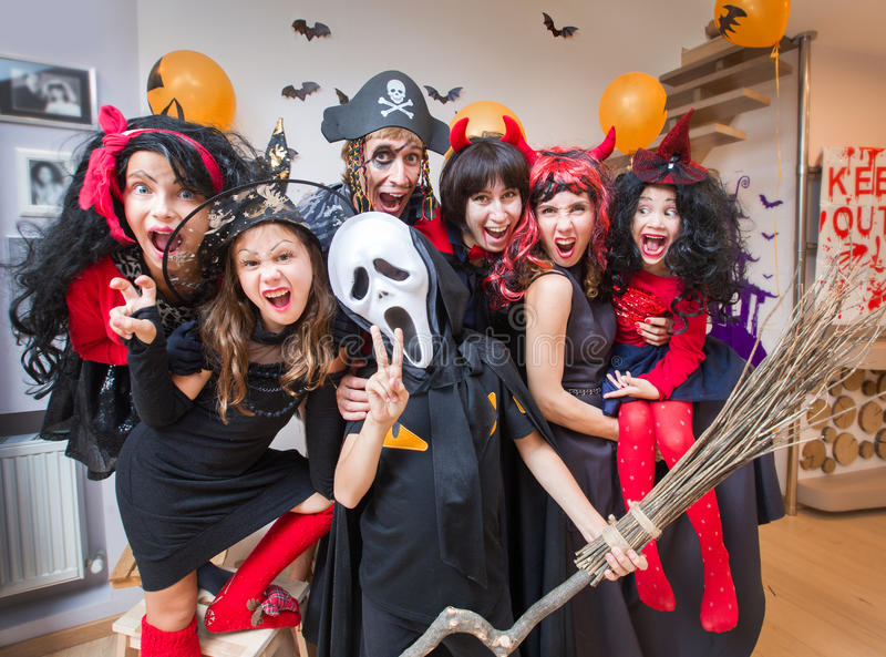 Big family in halloween costumes royalty free stock photography