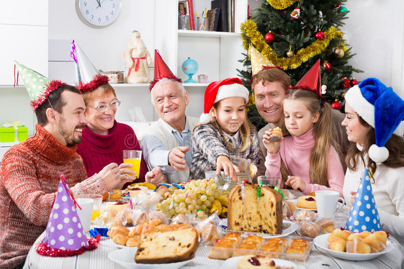Large family eating Christmas dinner royalty free stock photography