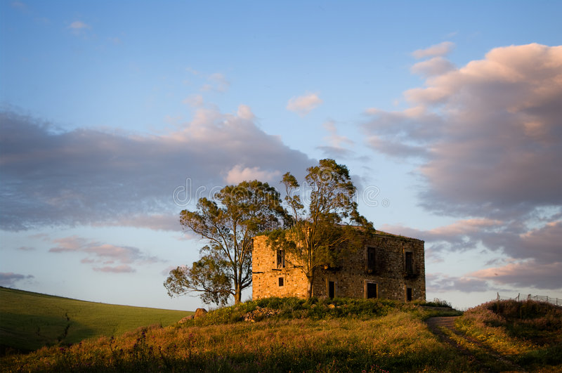 Large farmhouse in country. To twilight royalty free stock photo