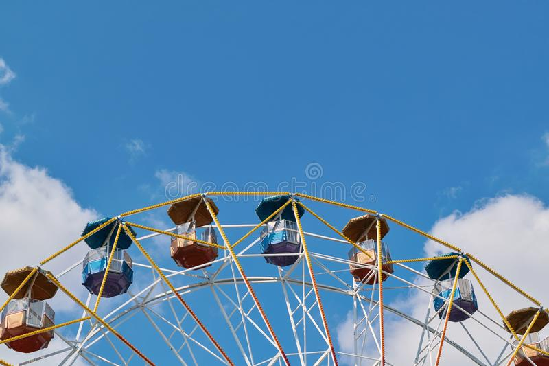 A large Ferris wheel at an amusement Park on a background of blue sky. stock photos