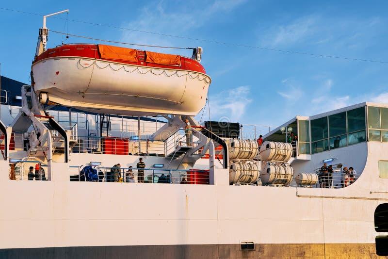 Large ferry at Mediterranean Sea in Port of Civitavecchia Italy. Civitavecchia, Italy - September 7, 2017: Large ferry with a boat at the Mediterranean Sea in stock photo