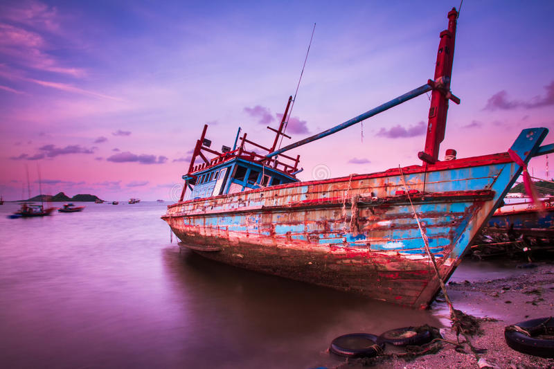 Large fishing boats beached at low tide. stock photo