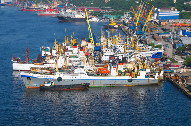 Large fishing trawler Novoural'sk in Vladivostok. Home port of Sovetskaya Gavan. Stands at the harbor wall shipyard stock photography