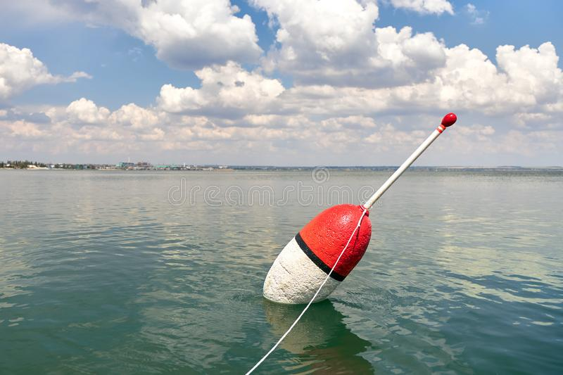 Large float on a calm surface of the sea as a symbol of successful fishing royalty free stock photo