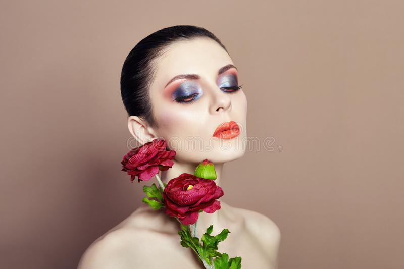Large flowers woman face makeup, art fashion flowers girl, nature face care, natural cosmetics and professional makeup, beige royalty free stock images