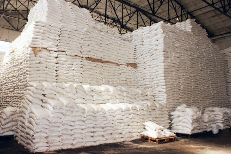 Large food warehouse with sugar sacks stock images