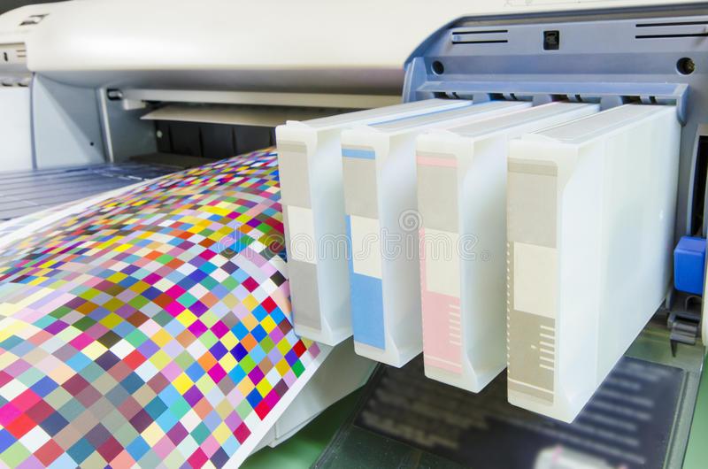 Large format ink jet printer cartridge. With color managament target paper roll stock photo