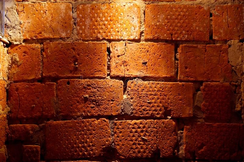 A large fragment of a rough masonry brick wall stock images