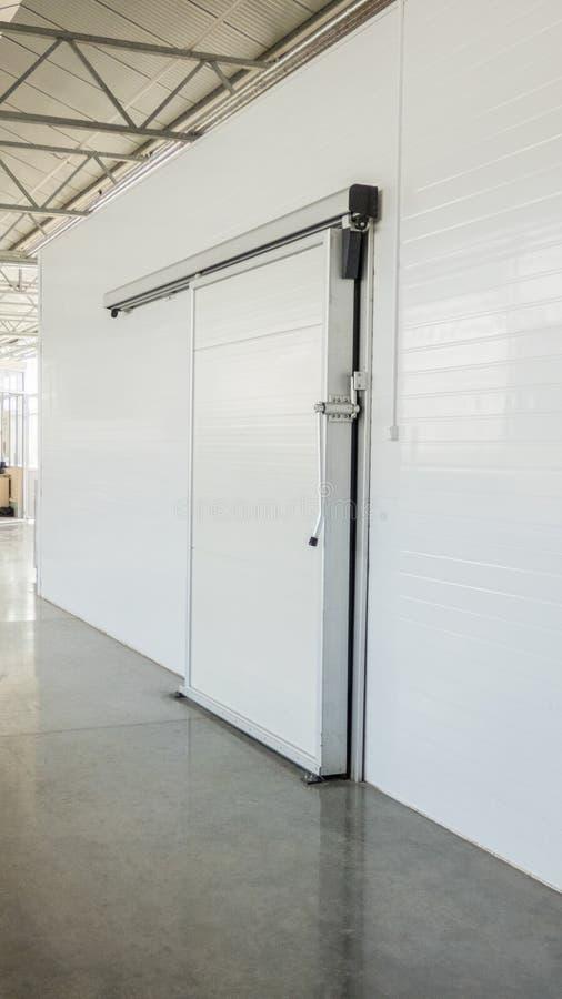 Warehouse freezer in the factory. Large freezer storage in the factory. closed door from warehouse stock photos