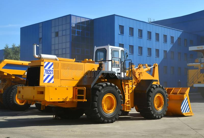 Large front-end loader or all-wheel bulldozer manufacture by the heavy vehicle plant. New heavy quarry equipment with bucket for sales. Coal mining, granite royalty free stock photo