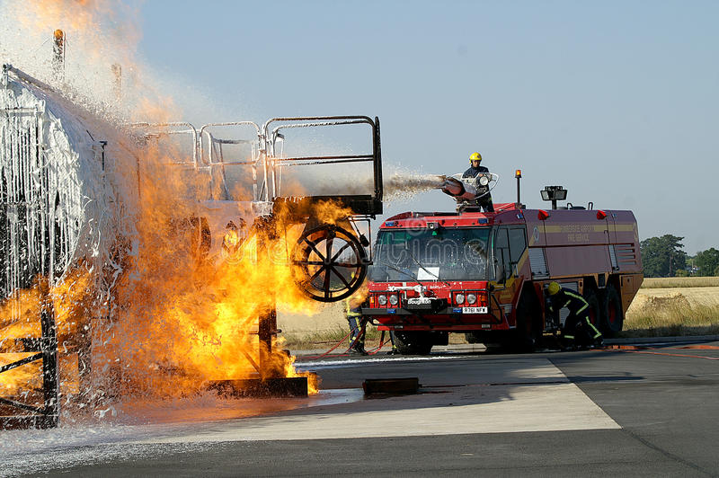 Large fuel fire. Fire engine at large fuel tank fire royalty free stock photography
