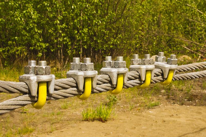 Large galvanized cable and clamps stock photo