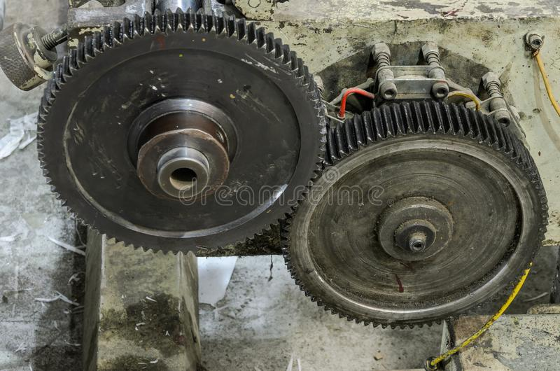 Large gears in oil on an industrial machine royalty free stock images