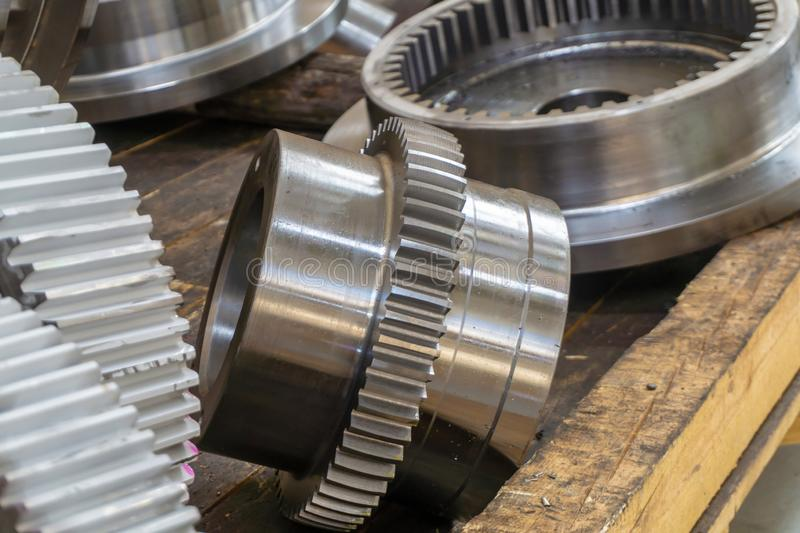 Large gears in stock on a rack after processing royalty free stock photos