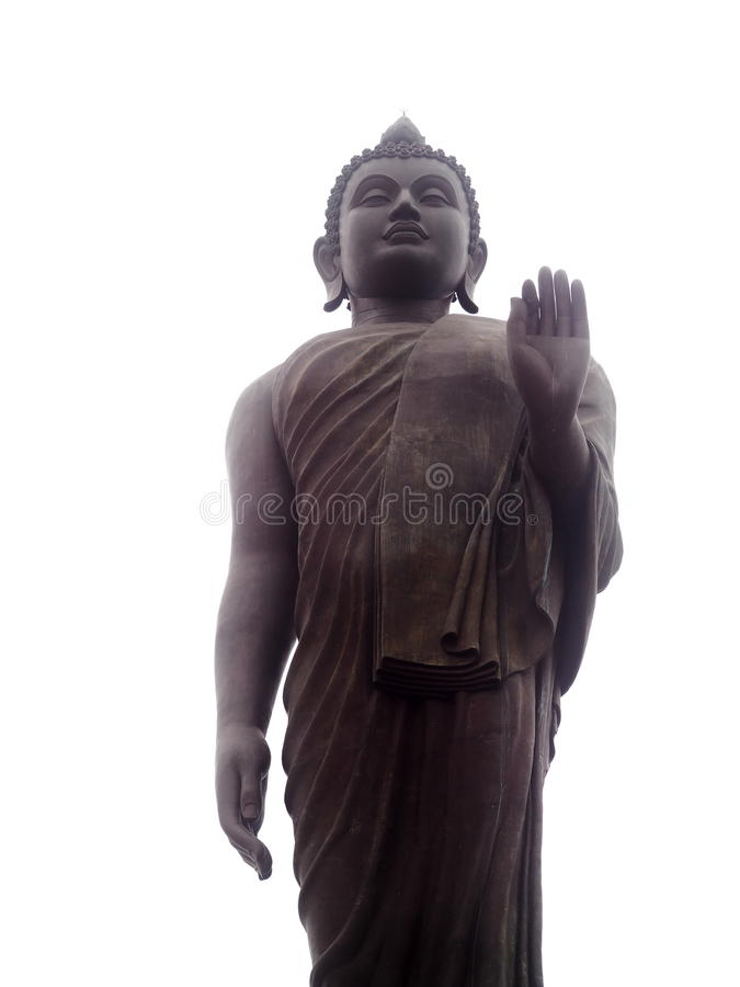Large giant standing walking posture brown colour metal BUDDHA statue. Figure as landmark for buddhism and tourist attraction in THAILAND outdoor isolated with royalty free stock photos
