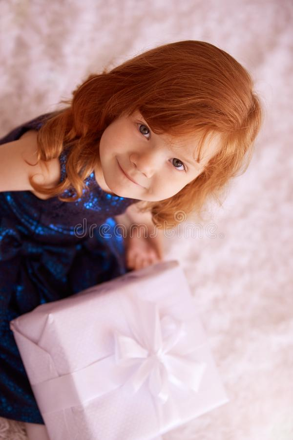 Large gift box. Little sweet girl royalty free stock photography