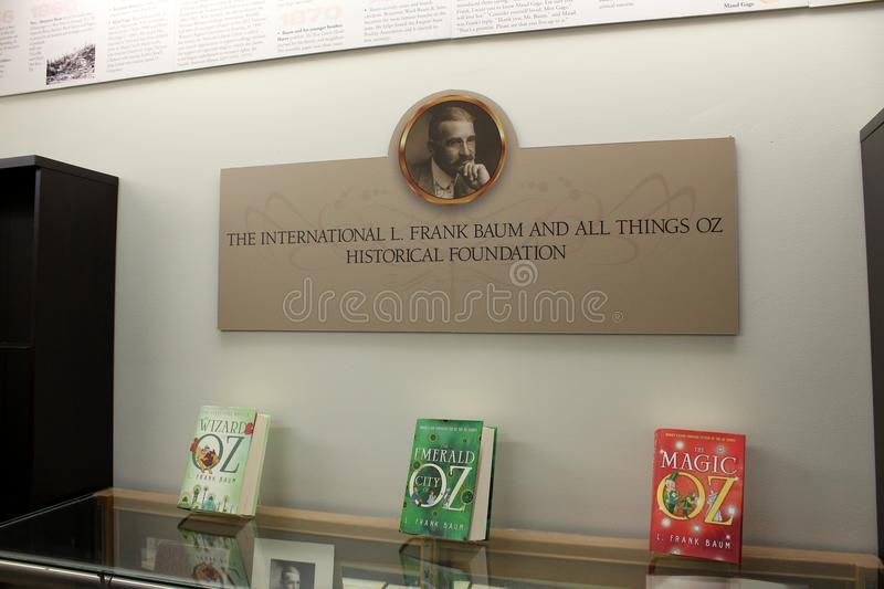 Large glass case with collector`s editions of L Frank Baum novels, All Things Oz Museum, Chittenango, New York, 2018 stock photography