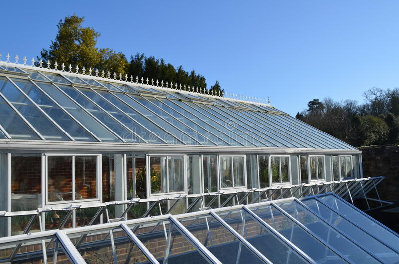 Large glass house and garden cloche. stock photography
