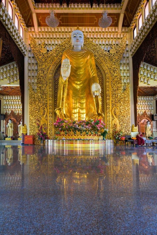 Large Gold Buddha Statue in Dhammikarama Burmese Temple. PENANG, MALAYSIA - MARCH 10, 2015: Large Gold Buddha Statue in Dhammikarama Burmese Buddhist Temple hall stock image