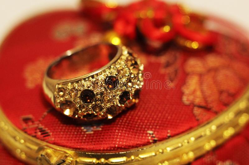 Large gold ring with stones royalty free stock photo